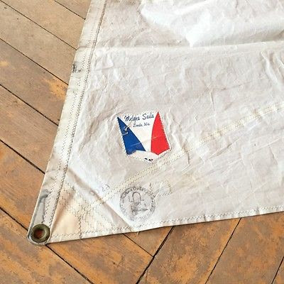 Old Melges sail with original rabbit ear logo