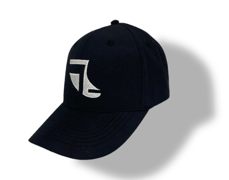 Angled image of Black ShoreTees Baseball Cap with White embroidered Fin Logo