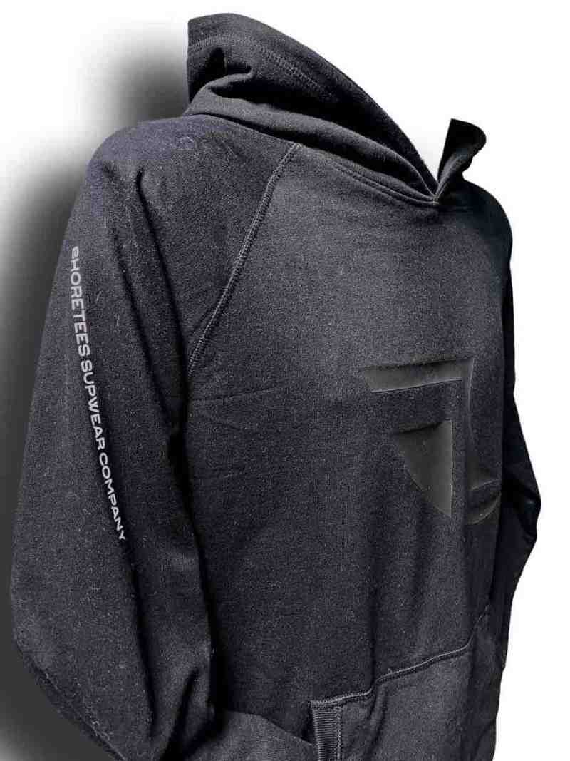Close up image of Balance Collection Premium Black Hoodie white arm silicone