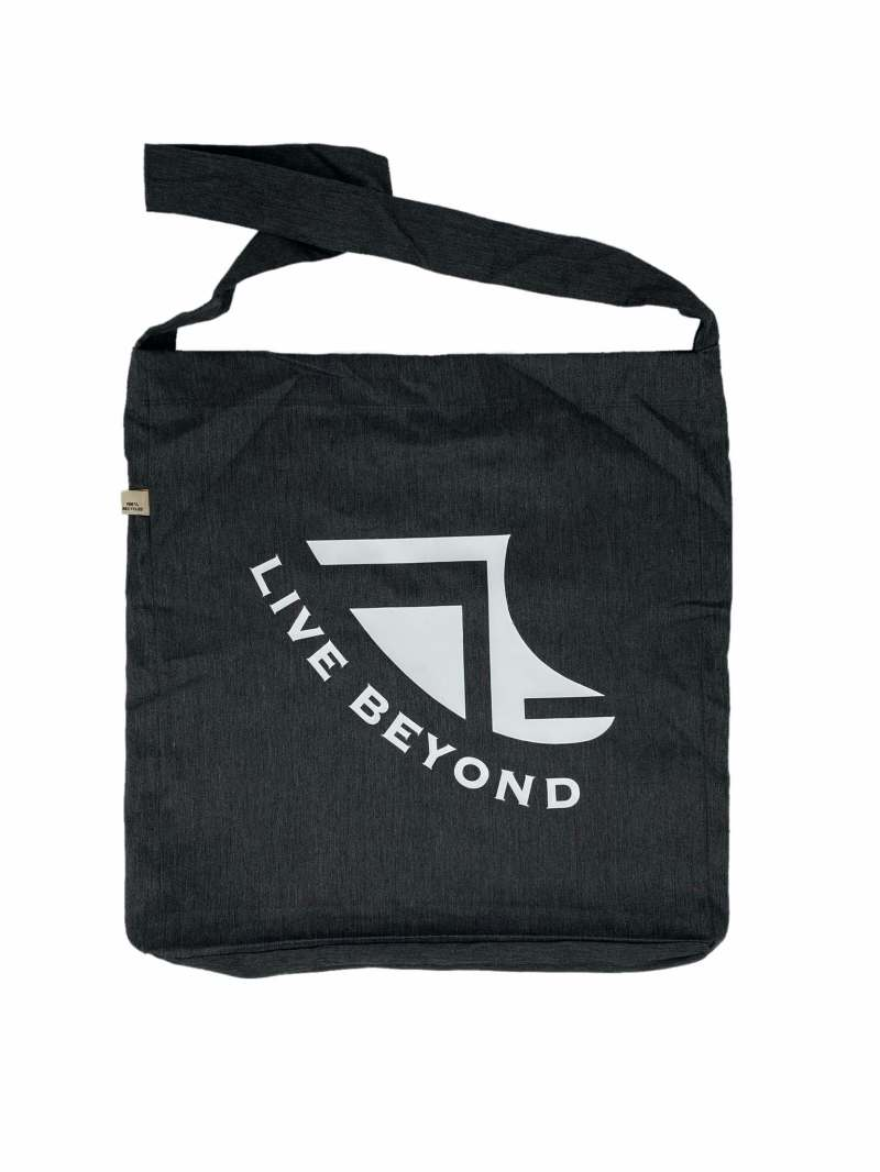Front of Recycled Melange Black Beach/Tote bag with White Logo & 'Live Beyond'