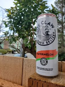 Watermelon white claw on fence post outside