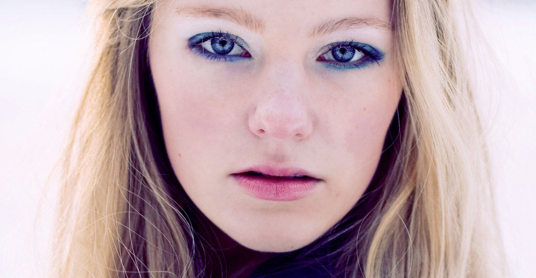 close up portrait of a pretty blond girl with blue eyeshadow