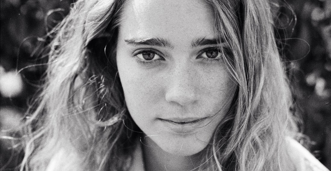 black and white portrait of a pretty girl with freckles