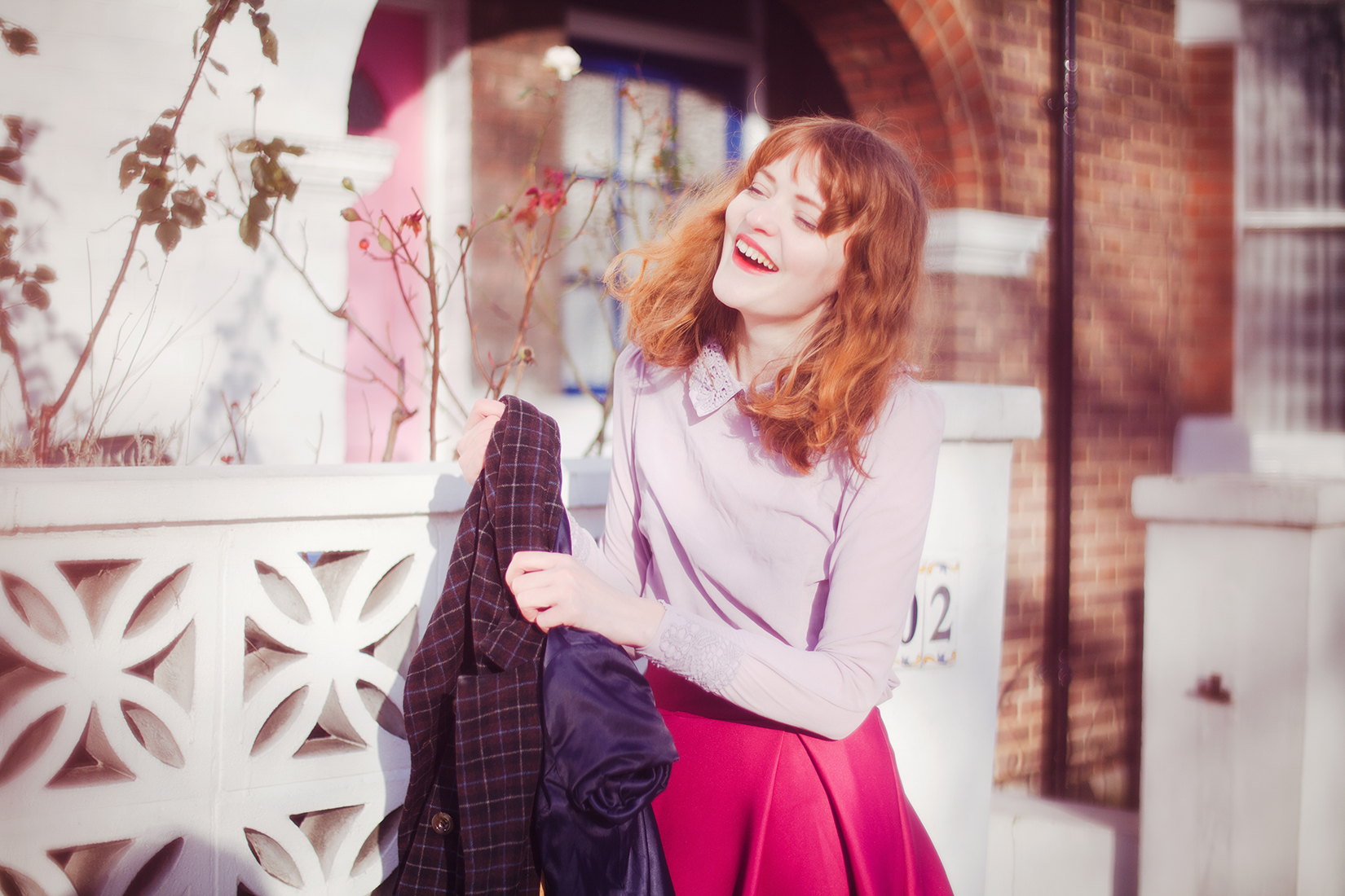 Fashion photoshoot behind the scenes - laughing redhead model by London based photographer Ailera Stone.