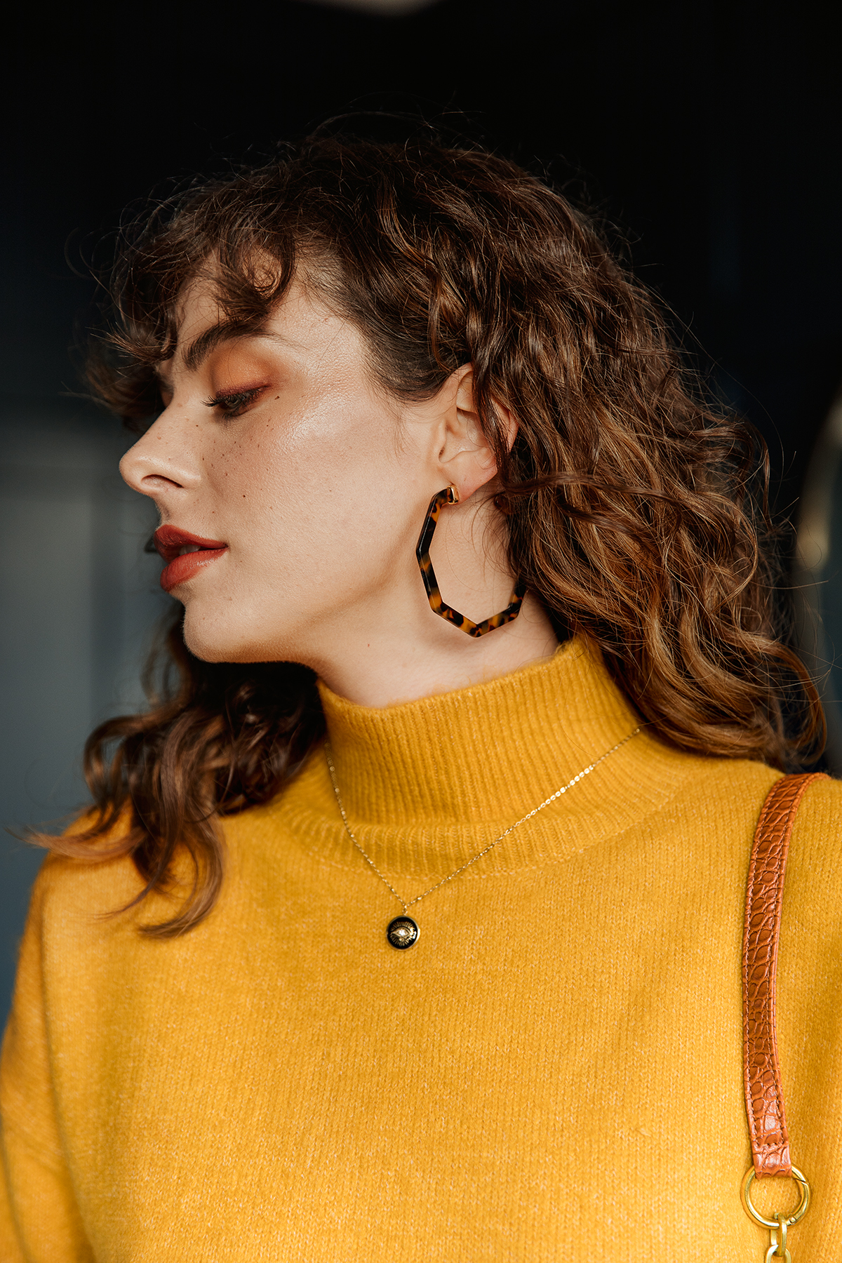 Sugar + Style fashion lookbook and e-com AW 2019. Close up detail of model in a yellow jumper. Shot by London based fashion photographer Ailera Stone