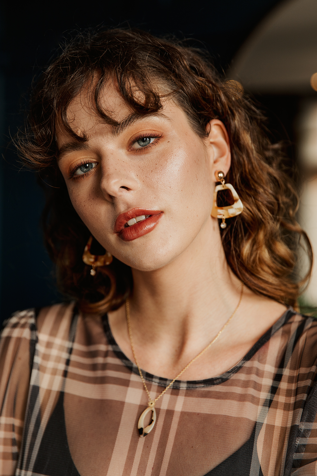 Sugar + Style fashion lookbook and e-com AW 2019. Portrait of model Alexandra in autumnal faux freckles make up. Shot by London based fashion photographer Ailera Stone