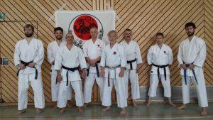 Nickos, Didier Lupo, Michael, Dieter, Fernando und Piotr vor der SCB Fahne
