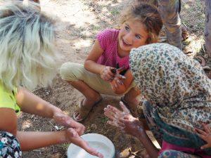 refugee kid washing hands