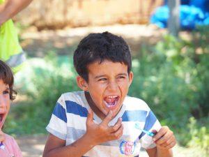 refugee kid toothpaste