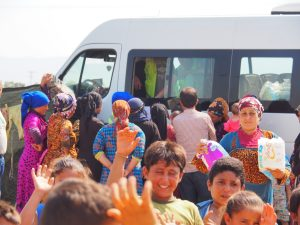 distributing goods refugee camp
