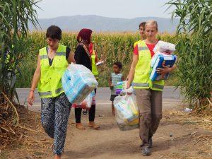 distributing goods refugee camps