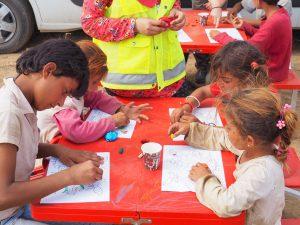 refugee children focused drawing
