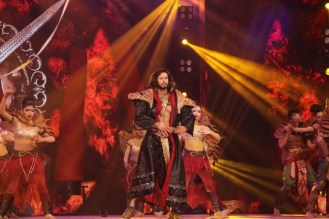 Rajneesh Duggal performing on stage