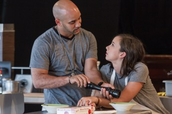 Victor Almanzar and Brittany Uomoleale in rehearsal for Steppenwolf Theatre Company's production of Grand Concourse, a Chicago premiere by Heidi Schreck, directed by ensemble member Yasen Peyankov. Grand Concourse runs July 2 – August 30, 2015 in Steppenwolf's Downstairs Theatre (1650 N Halsted St).