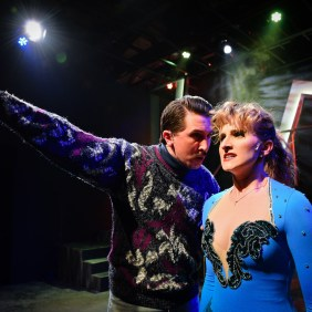 left to right) Justin Adair and Courtney Mack in Underscore Theatre Company's Chicago premiere of TONYA AND NANCY: THE ROCK OPERA. Photo by Evan Hanover.