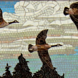 Heritage smaller glass mosaic mural located over the display case Canada Geese in flight.