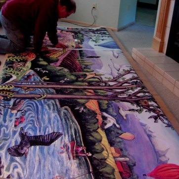 Carl working on the enlarged pattern for the mosaic mural which was generated from the original oil painting.