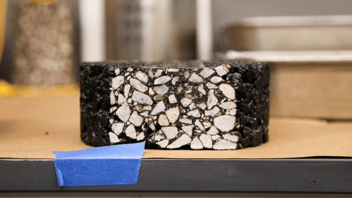 An asphalt pavement test mixture sample designed by the Mizzou Asphalt Pavement and Innovation Lab that is ready for further testing to determine its strength and durability.