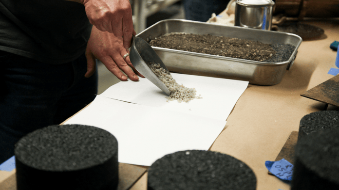 Lab staff in the Mizzou Asphalt Pavement and Innovation Lab, or MAPIL, show the plastic waste particles that are being added to the pavement mixture. The lab is located inside the MU College of Engineering.