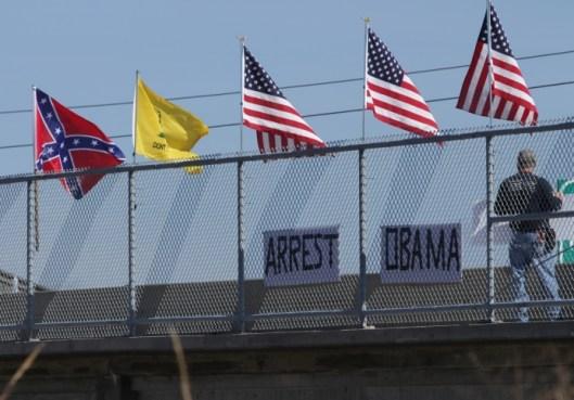 Anti-Obama demonstration on an overpass over U.S. Highway 50 in Warrensburg, Missouri - October 10, 2015.
