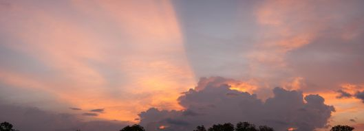 Sunrise. F 5.6, 1/100, ISO 400, 55 mm. Panorama stitched from seven frames.