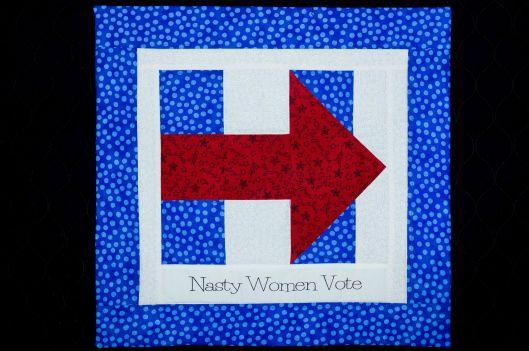 """""""Nasty Women Vote"""" -  quilt block, machine pieced, machine quilted, 16.5 in.  x 16 in., Joan Ferguson."""