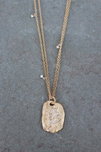 Girl Power pendant jewelry made from recycled sterling silver and 18k gold with ethically-sourced diamonds