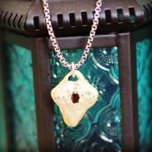 With the look of a magical amulet, our Heirloom Necklace was designed to be treasured by you and passed down throughout time. #showthelovejewelry #heirloomnecklace #amulet #diamonds