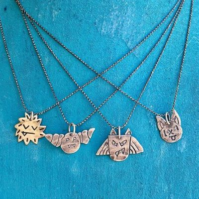 """These adorable Little Monster Protector Charm necklaces are sure to put a smile on anyone's face. Choose Barb, Fang, Dexter or Coco Puff. Inscribed on the back with 'Bad Spirits Go Away!' the monsters will do their best to keep you out of trouble! Receive 50% using the code """"monster50"""" ️ #showthelovejewelry"""