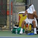 Rafael Nadal shirt change Cincinnati Western and Southern Open shirt over head bronzed tan skin Sunday practice shirtless naked abs biceps calves muscles