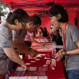A staff of HK ICM trying to answer questions regarding Chinese traditional culture