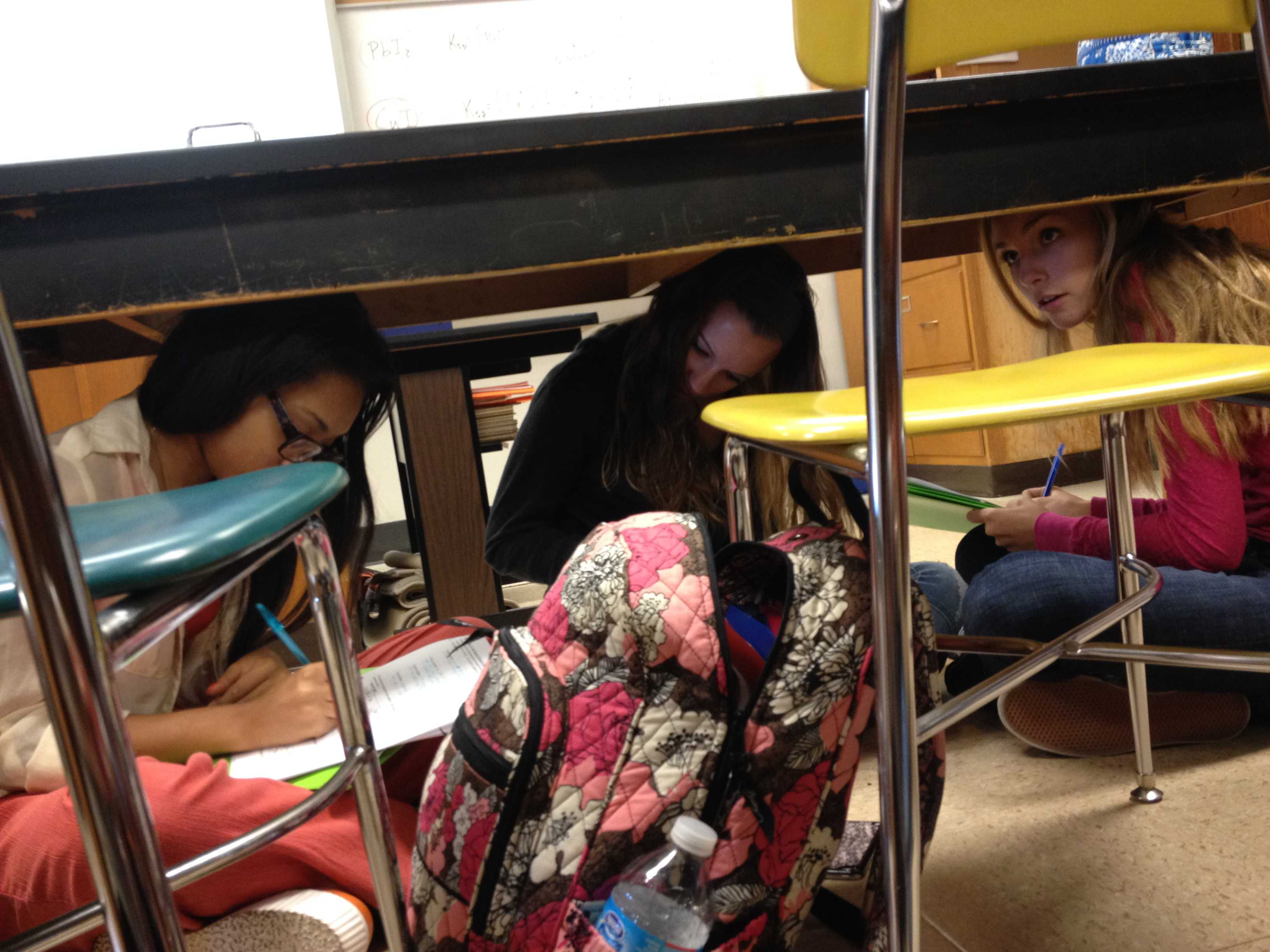 Students Duck And Cover For The Earthquake Drill