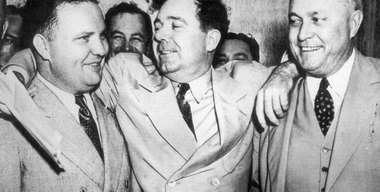 Sen. Huey Long, middle, was allegedly assassinated by Dr. Carl Weiss in the Louisiana State Capitol in September 1935. But do we have the whole story? Photo from www.kingsacademy.com