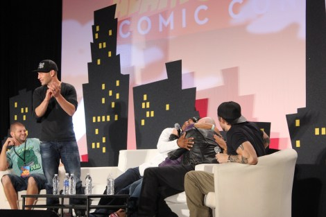 Jon Bernthal, Lawrence Gilliard Jr., and Michael Rooker hug a fan on stage at
