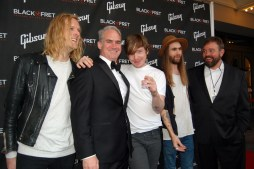 Black Fret co-founders Matt Ott and Colin Kendrick pose for the cameras with Danny Malone and band at the red carpet for the Black Ball gala.