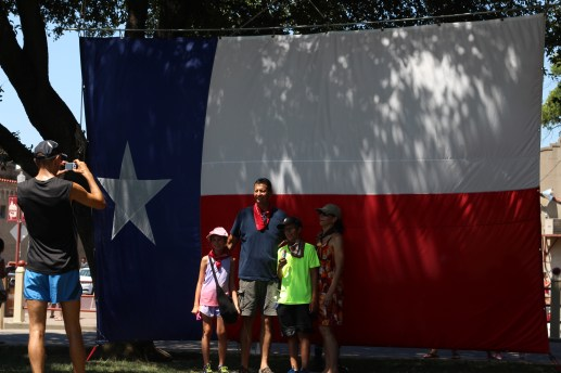 It's not a real Texas party without an over-sized Texas flag. / Photo by Parker Conley