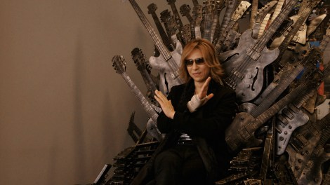 "Yoshiki sits triumphantly atop a guitarthemed version of the Iron Throne in Drafthouse Films' ""We Are X."" / Courtesy of Drafthouse Films"