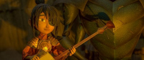 2500.0080.still.laika.0001 Kubo (voiced by Art Parkinson) plays his shamisen as Monkey tells a story by the campfire in animation studio LAIKA's epic action-adventure KUBO AND THE TWO STRINGS, a Focus Features release. Credit: Laika Studios/Focus Features
