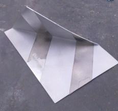 Folded aluminium piece