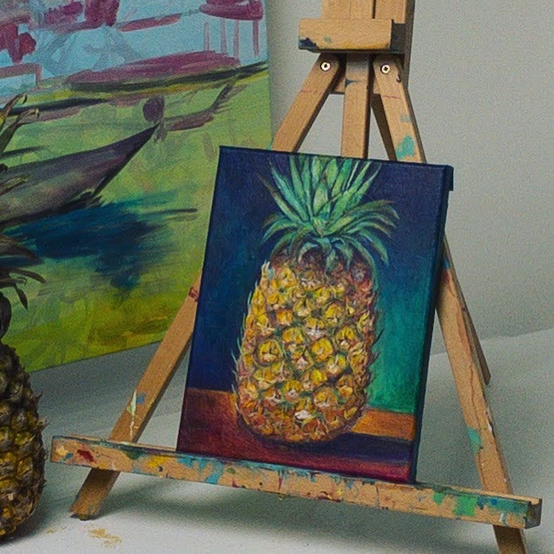 Pineapple Painting By Shukri Khan displayed on easel