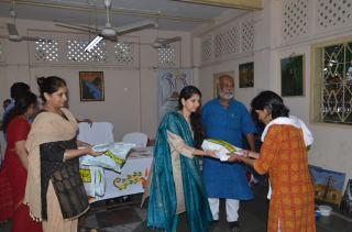 Awardee receiving recognition from Kaushiki Chakraborty