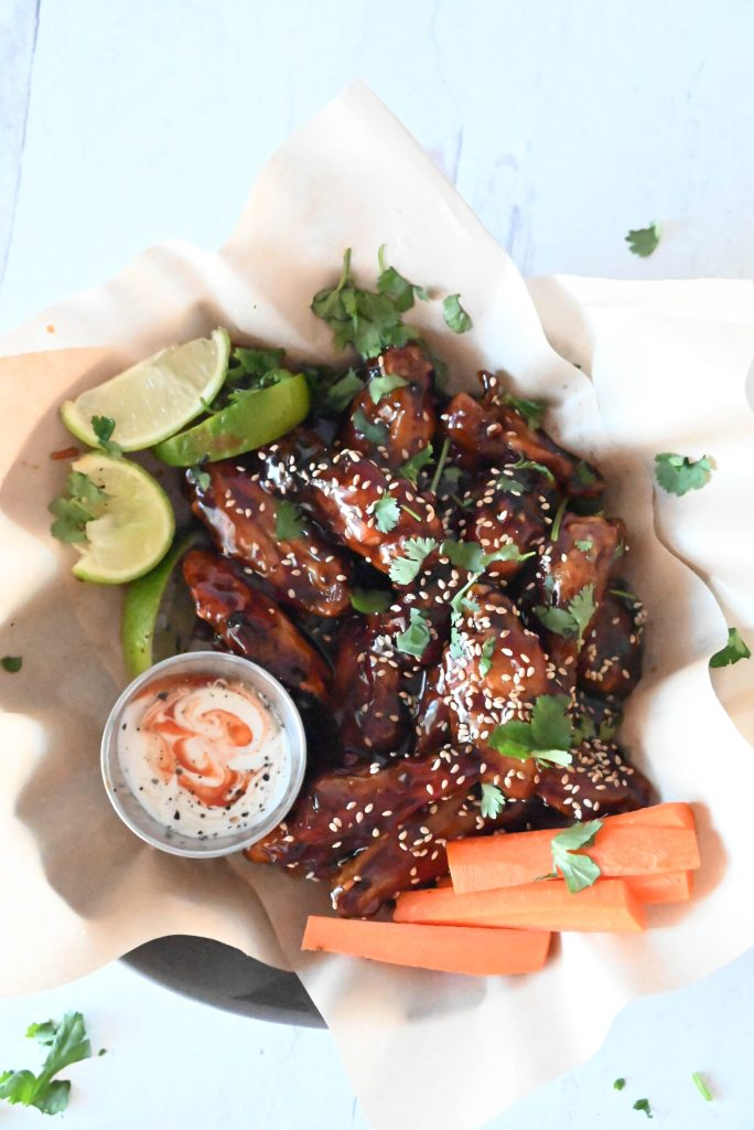 Chicken wings in a dish with sesame seeds