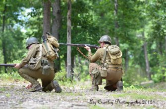 """World War II-era 30th Infantry Division soldiers demonstrating their M1 """"Garand"""" and M1903 Springfield service rifles."""