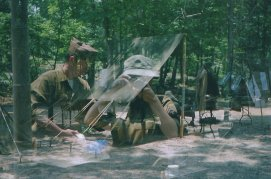 Double-exposure of two of us taking each other's picture and a camping fly.