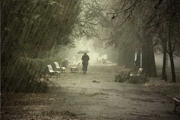 a man walking in rain