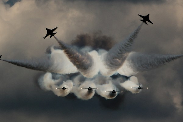 fighter jets flying in different directions