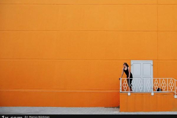 Lady standing near a door wearing tank top