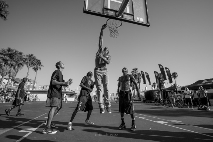 venice beach basket ball players play ball