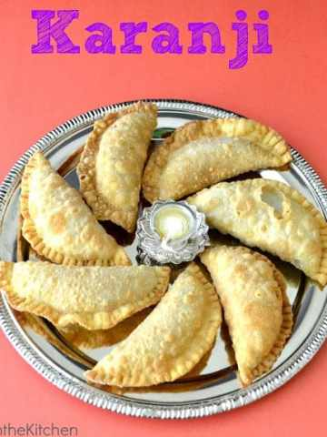 Seven karanji served on a silver plate