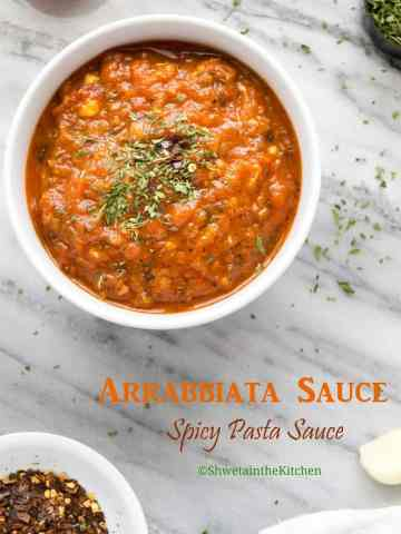 Arrabbiata sauce in a white bowl on a marble work surface